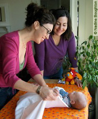 a MotherCare doula works with a Boston mother and her new baby